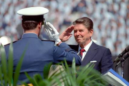 Photo of President Reagan, the Great Communicator, saluting the troops