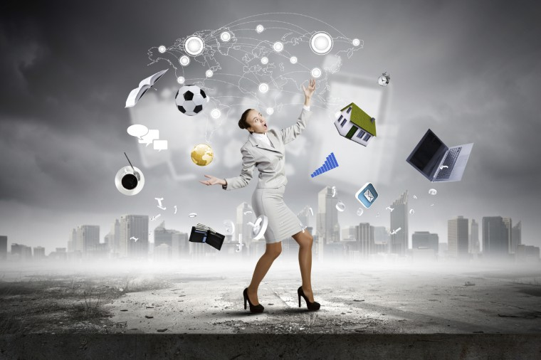 Photo of a business woman juggling picutres of a house, a soccer ball, a financial graph, a wallet full of dollars, a calendar. She appears overwhelmed. Chaos is not Your Friend.