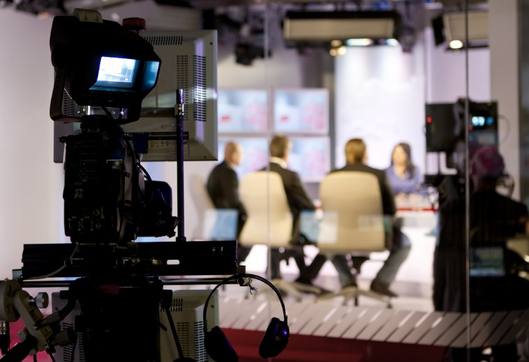 Beware of the Experts - Photo of a media panel of experts at television studio