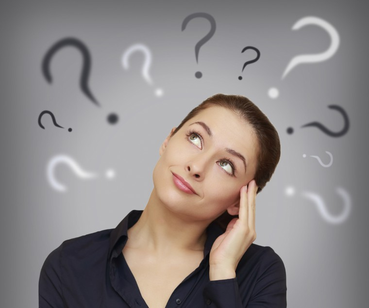What is a Cap Rate? - Beautiful business woman with question mark above the head